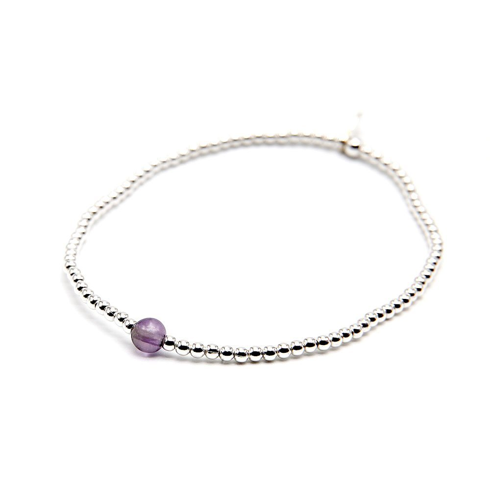 """Handmade bracelet with real silver beading, adorned with a violet Amethyst stone, and OZZ authentic charm. <strong>Web exclusive</strong>: buy 2 beaded bracelets and get a gemstone bracelet for free! <a href=""""https://www.ozz-jewelry.com/product-category/gemstone-bracelet-gift/"""" target=""""_blank"""" rel=""""noopener"""">Click for full offer »</a> - Ozz Silver Jewelry"""