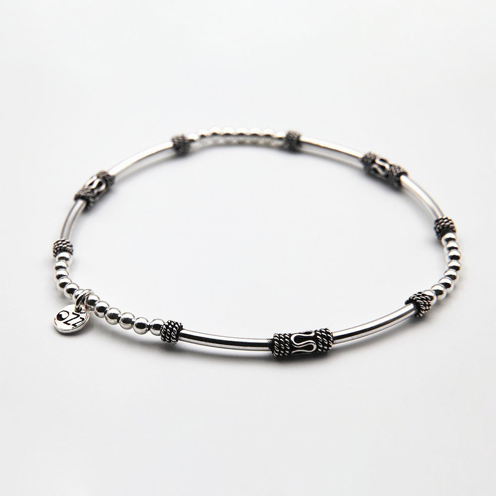 Handmade bracelet with real silver beading, adorned with 6 cylinders beads, Bali ornaments and OZZ authentic charm. - Ozz Silver Jewelry