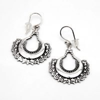 This pack includes a sterling silver flower pendant necklace, alongside a pair of sterling silver Bali hook earrings. Both the necklace and the earrings are decorated with Jawan, a decorative art originating in Bali, which uses small droplets of silver to create a pattern. - Ozz Silver Jewelry