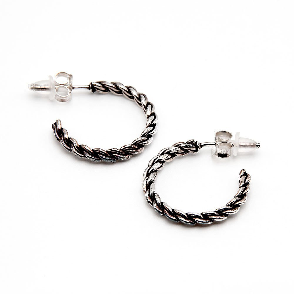 A pair of silver J-hoop earrings with a braided rope design and butterfly backing. - Ozz Silver Jewelry