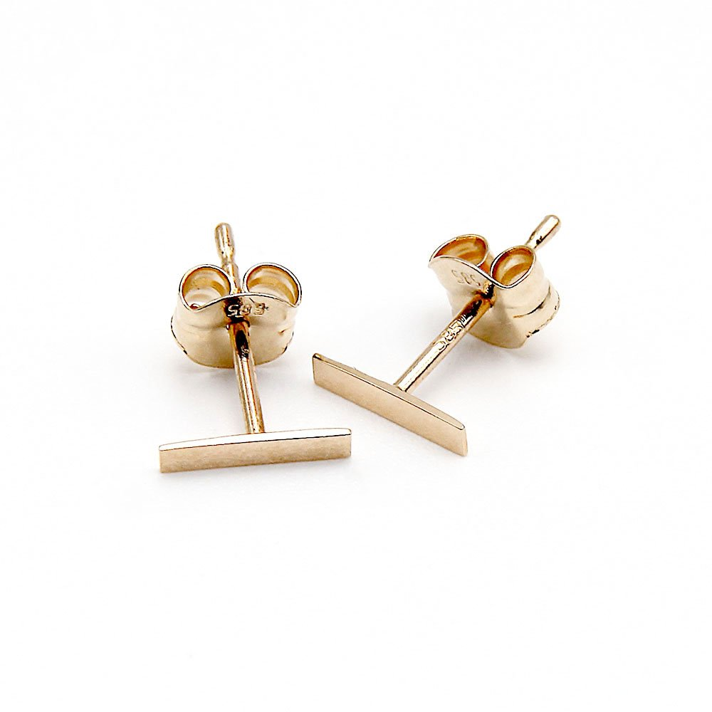 Pair of 14 Karat gold stud earrings with a smooth bar detail and butterfly backing. - Ozz Silver Jewelry