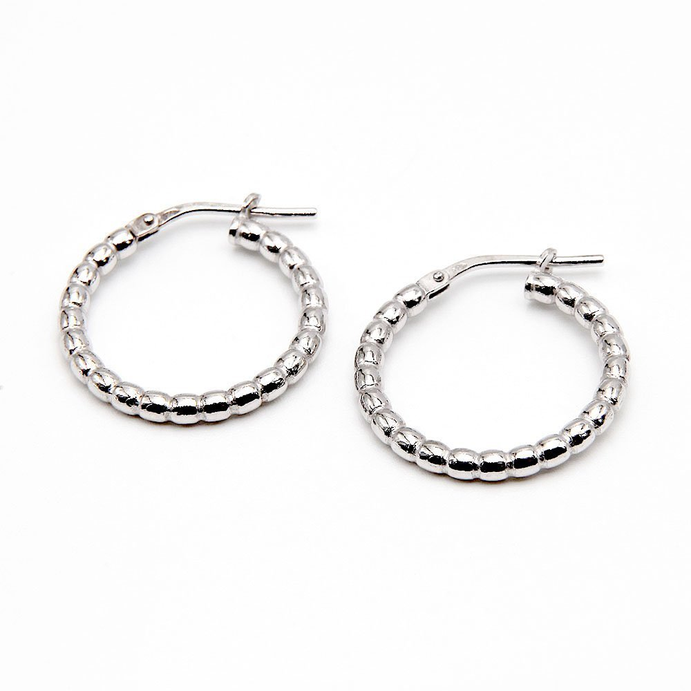 A pair of embellished Bali style silver hoop earrings. - Ozz Silver Jewelry