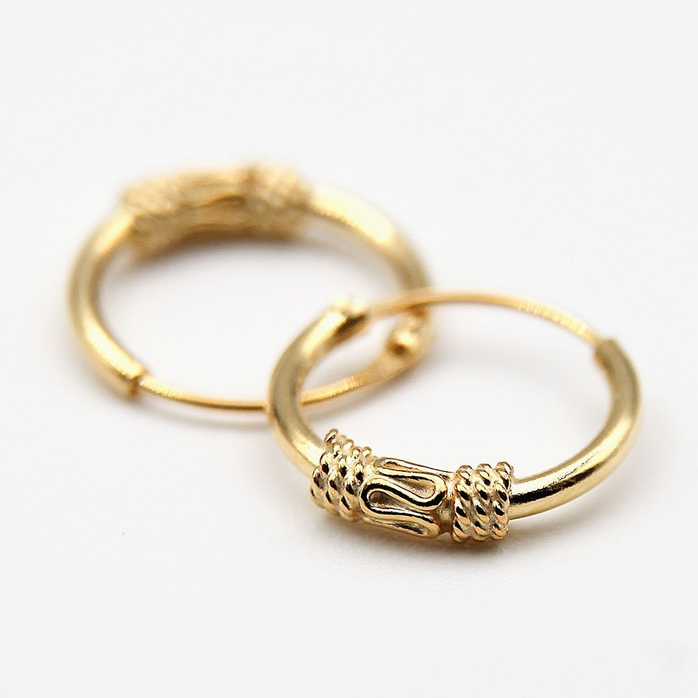 Pair of gold plated silver Bali Hoop earrings with a delicate decorative snake design. - Ozz Silver Jewelry