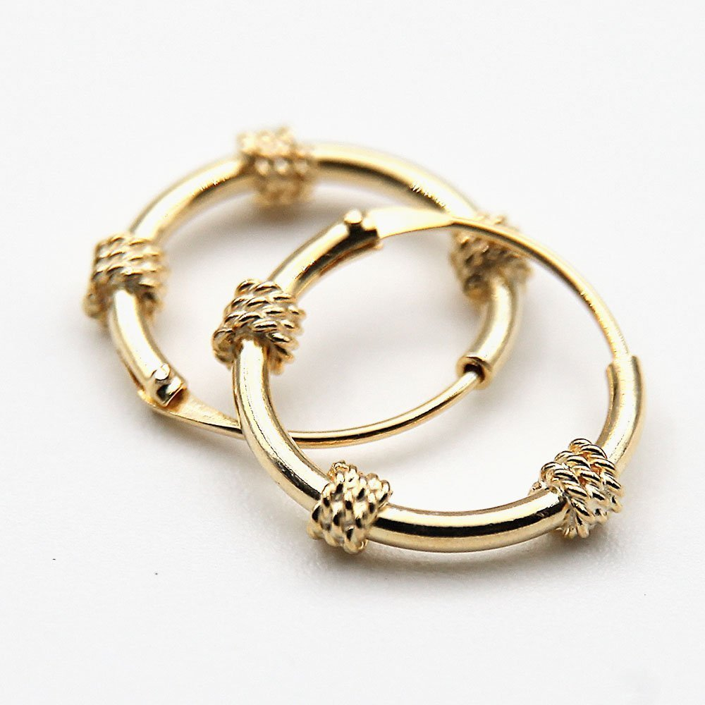 """<div class=""""woocommerce-product-details__short-description""""> Pair of chunky gold plated silver Bali Hoop earrings with decorative woven basket design. </div> - Ozz Silver Jewelry"""