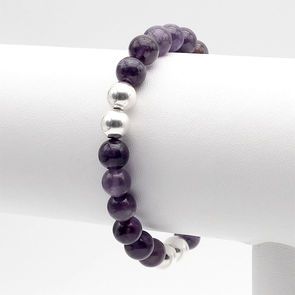 """Handmade bracelet with 8mm Amethyst stones and real silver accent beads. <strong>Web exclusive</strong>: buy 2 beaded bracelets and get a gemstone bracelet for free! <a href=""""https://www.ozz-jewelry.com/product-category/gemstone-bracelet-gift/"""" target=""""_blank"""" rel=""""noopener"""">Click for full offer »</a> - Ozz Silver Jewelry"""