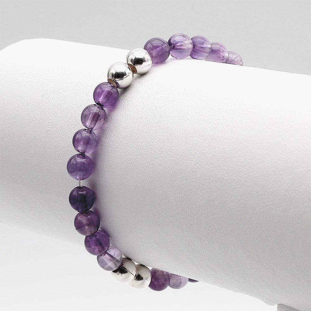 """Handmade bracelet with 6mm Amethyst stones and real silver accent beads. <strong>Web exclusive</strong>: buy 2 beaded bracelets and get a gemstone bracelet for free! <a href=""""https://www.ozz-jewelry.com/product-category/gemstone-bracelet-gift/"""" target=""""_blank"""" rel=""""noopener"""">Click for full offer »</a> - Ozz Silver Jewelry"""