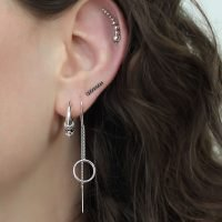 Pair of silver circle cutout pull through earrings. - Ozz Silver Jewelry