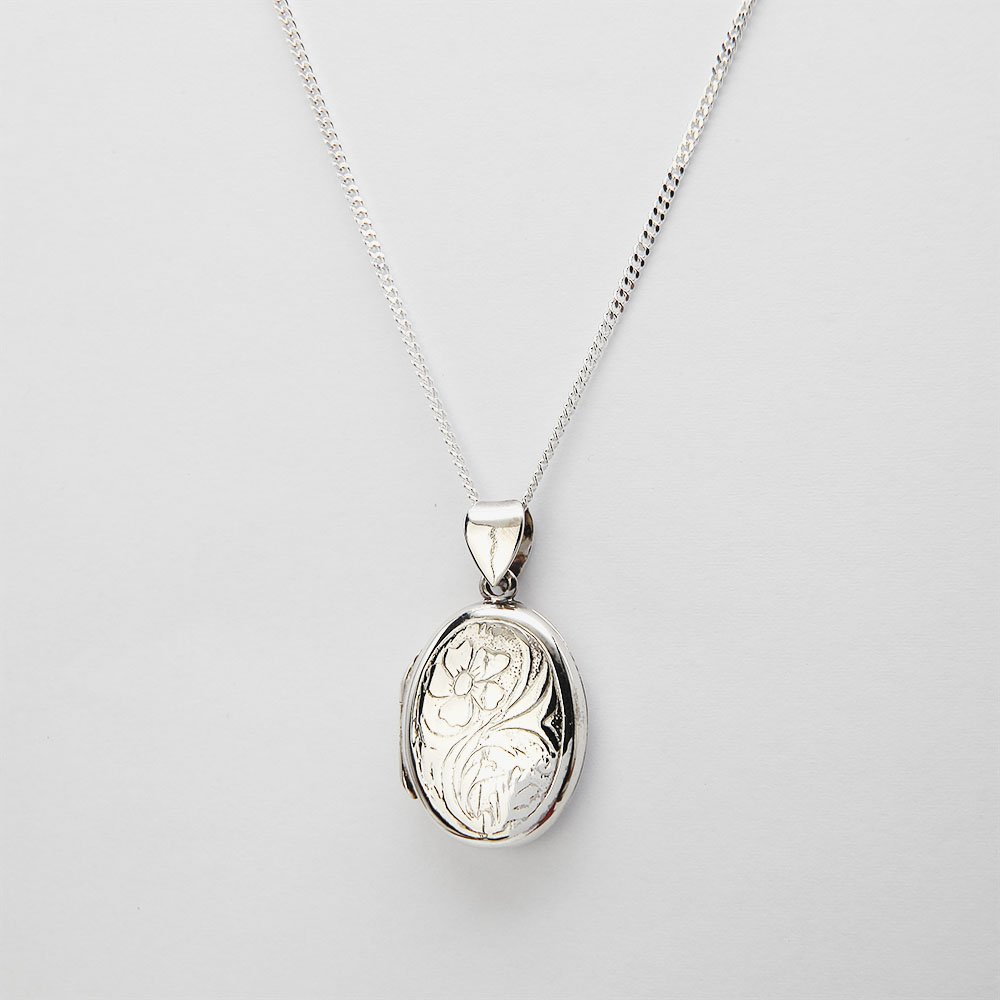 A silver necklace with a medallion pendant and adjustable ring clasp. - Ozz Silver Jewelry