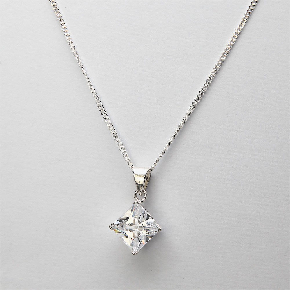 A silver necklace with a diamond-shaped cubic zirconia crystal pendant and adjustable ring clasp. - Ozz Silver Jewelry