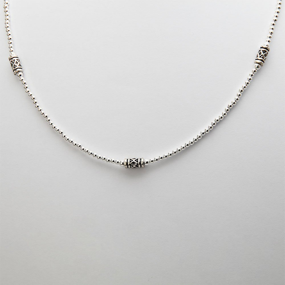 A beaded silver necklace with dark silver beads and an adjustable ring clasp. - Ozz Silver Jewelry