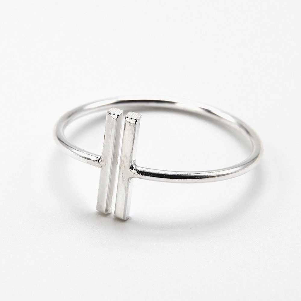 """Silver ring with a geometric design. <a href=""""https://www.ozz-jewelry.com/size-guides/"""" target=""""_blank"""" rel=""""noopener noreferrer"""">See size guide</a>. - Ozz Silver Jewelry"""