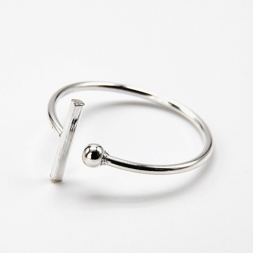 """Silver ring detailed with a single ball and bar. <a href=""""http://www.ozz-jewelry.com/size-guides/"""" target=""""_blank"""" rel=""""noopener noreferrer"""">See size guide.</a> - Ozz Silver Jewelry"""