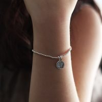 Handmade bracelet with real silver beading, adorned with Tree of Life tag, and OZZ authentic charm. - Ozz Silver Jewelry