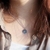 A silver necklace with a compass pendant and adjustable ring clasp. - Ozz Silver Jewelry
