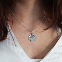 A silver necklace with an angel pendant and adjustable ring clasp. - Ozz Silver Jewelry