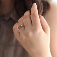 """A detailed silver ring with a sweet tiara design. <a href=""""https://www.ozz-jewelry.com/size-guides/"""" target=""""_blank"""" rel=""""noopener noreferrer"""">See size guide</a>. - Ozz Silver Jewelry"""