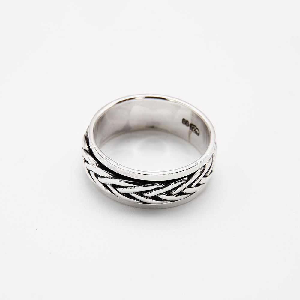 """Jewelry that gives you something to fiddle with when trying to focus or relax. This ring features a braided Bali pattern. <a href=""""https://www.ozz-jewelry.com/size-guides/"""" target=""""_blank"""" rel=""""noopener noreferrer"""">See size guide</a>. - Ozz Silver Jewelry"""