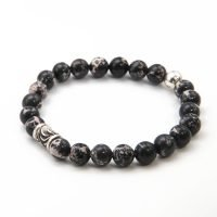 This OZZ bracelet for men features 8mm Black Sea Sediment stones, and two sterling silver beads. - Ozz Silver Jewelry