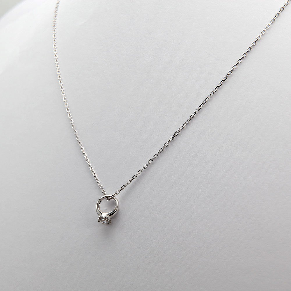 Feminine sterling silver necklace with a petite ring charm and crystal. - Ozz Silver Jewelry