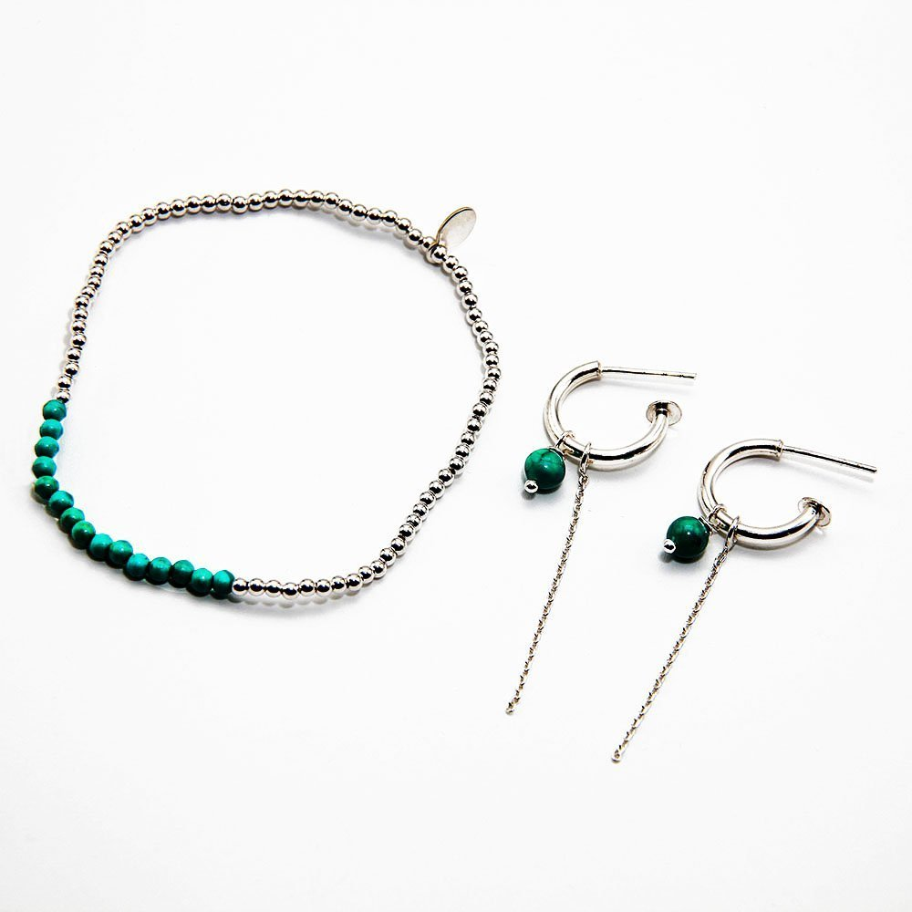 This pack contains a pair of Turquoise gemstone J-Hoop earrings in sterling silver, and a bracelet with Turquoise and sterling silver beads. The bracelet is hand-threaded on an elastic silicone thread. - Ozz Silver Jewelry