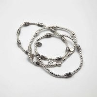 A pack of 3 sterling silver Bali bracelets. Each bracelet is hand-threaded on an elastic silicone thread and contains an OZZ authentic charm. - Ozz Silver Jewelry