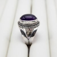 """Sterling silver ring set with an Amethyst stone. The violet Amethyst stone is considered a cleansing gem, ridding the wearer of bad energy and restoring calmness. <a href=""""https://www.ozz-jewelry.com/size-guides/"""" target=""""_blank"""" rel=""""noopener noreferrer"""">See size guide</a>. - Ozz Silver Jewelry"""