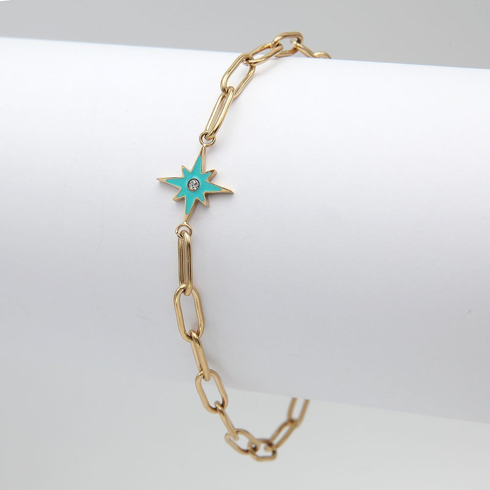 Stainless steel bracelet in a gold finish, with a Turquoise Northern Star detail and adjustable ring clasp. - Ozz Silver Jewelry