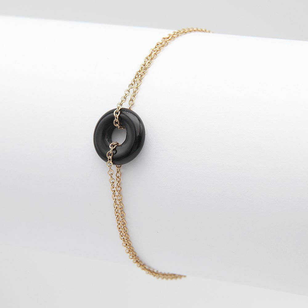 Stainless steel chain bracelet with a gold finish, a black torus bead detail, and adjustable ring clasp. - Ozz Silver Jewelry