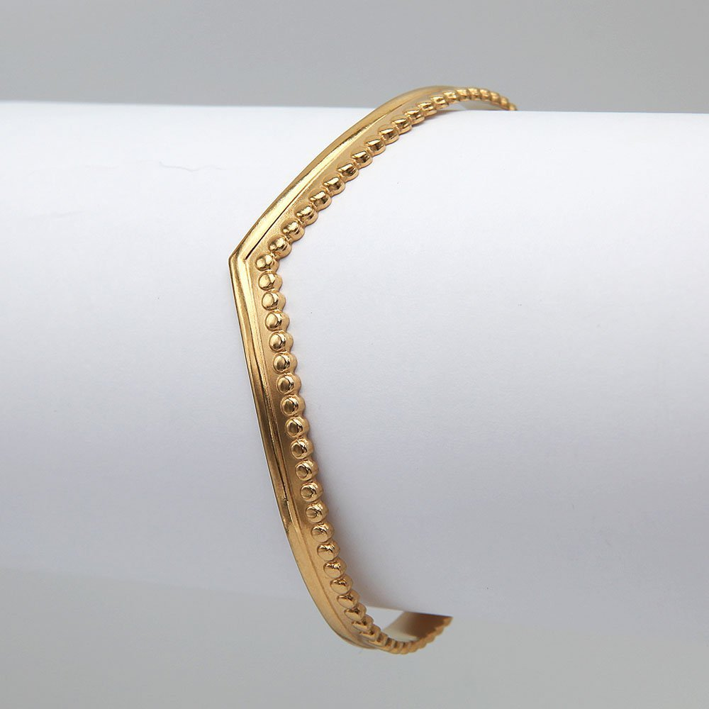 Stainless steel bangle in a gold finish, with a chain and ring clasp for added security. - Ozz Silver Jewelry