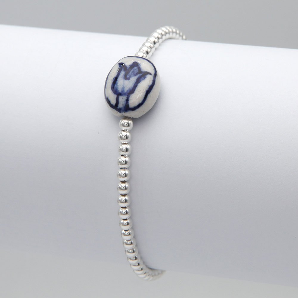 Sterling silver beads bracelet with a ceramic Delft Blue tulip charm, threaded by hand on an elastic thread. - Ozz Silver Jewelry
