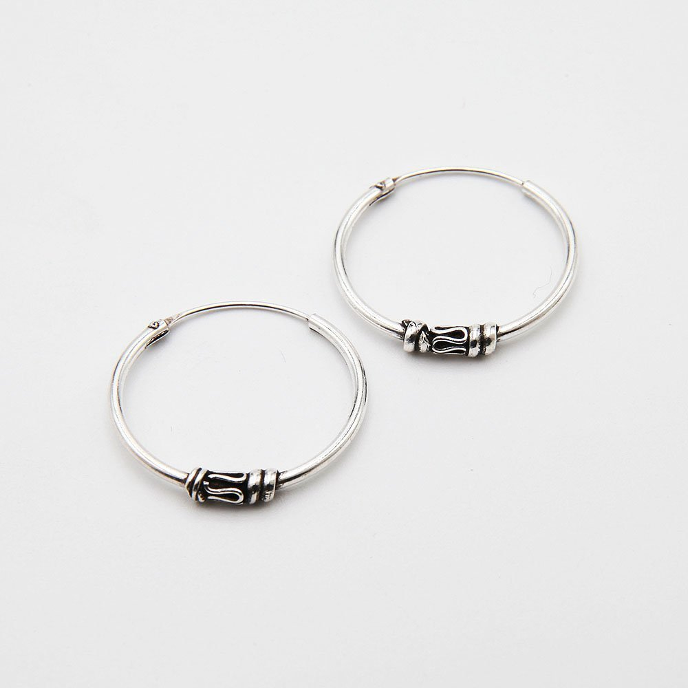 A pair of silver Bali hoop earrings, featuring a decorative snake detail and delicate design. - Ozz Silver Jewelry