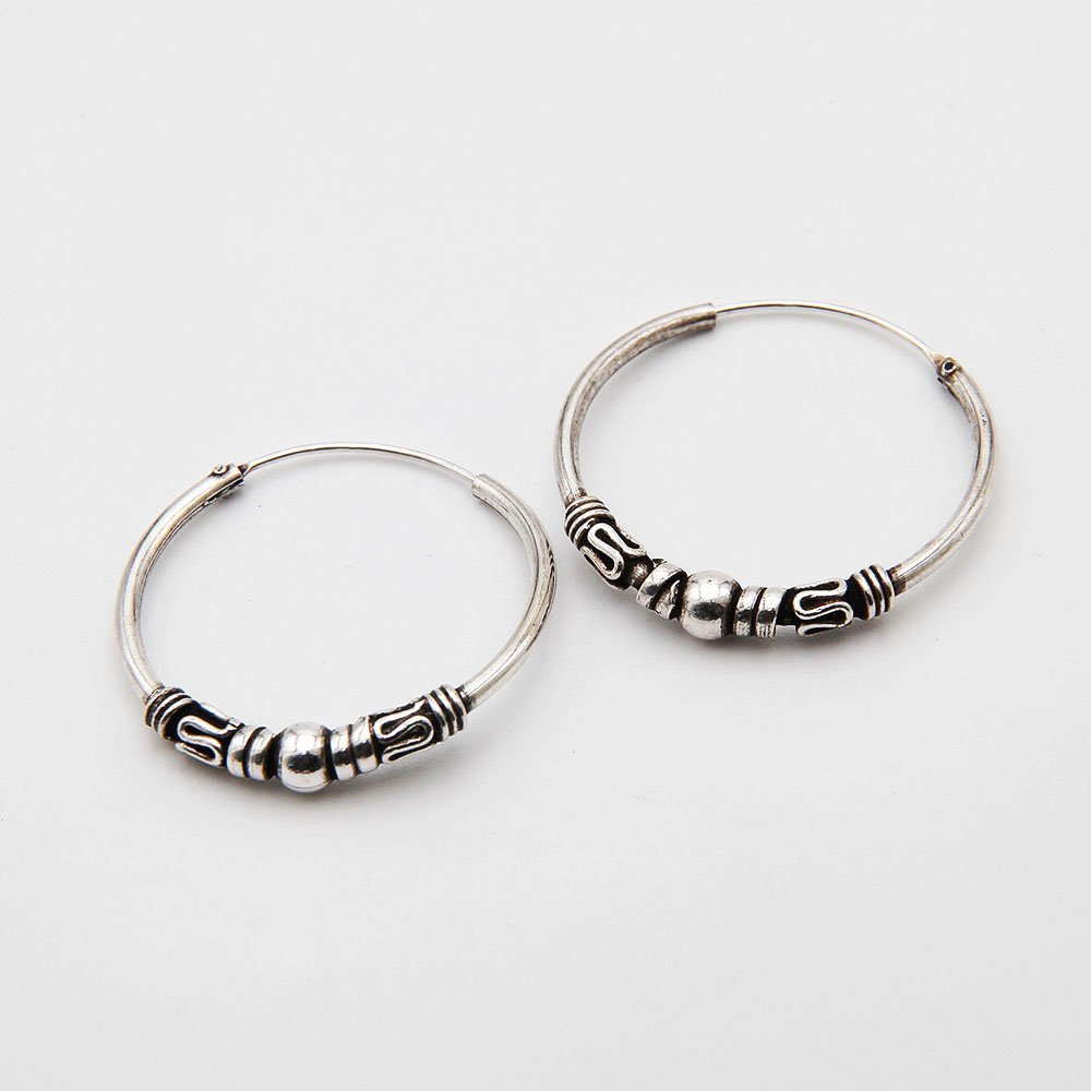 A pair of 25mm silver Bali hoop earrings, featuring various decorative Bali elements. - Ozz Silver Jewelry