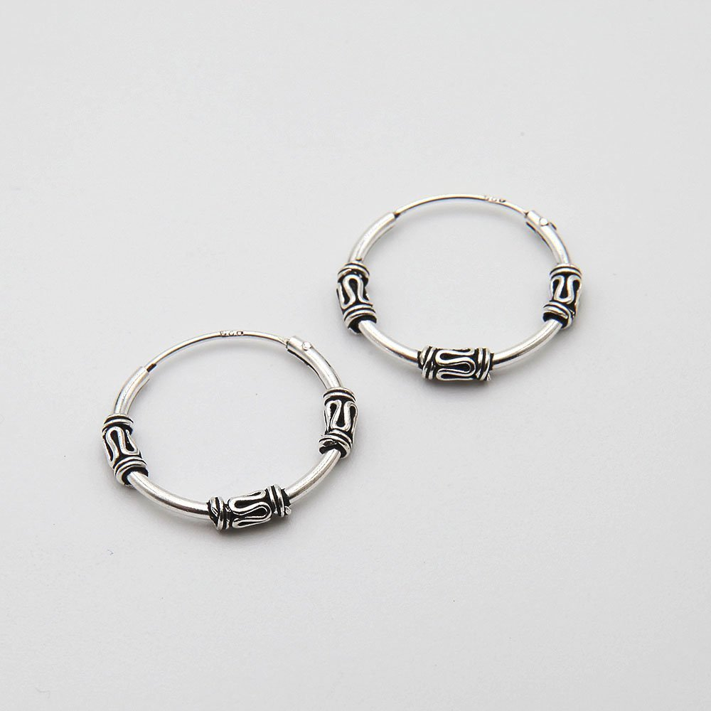 A pair of 30mm silver Bali hoop earrings, featuring 3 snakes. - Ozz Silver Jewelry