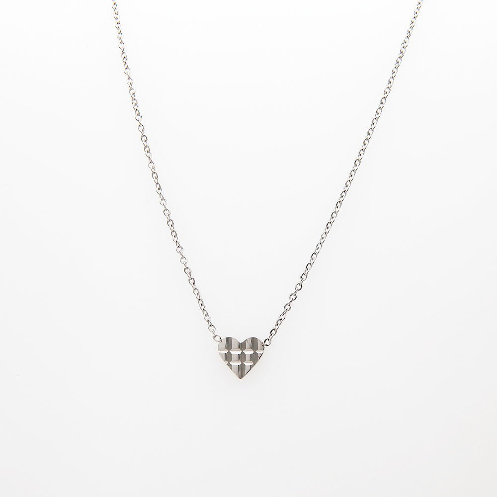 Stainless steel necklace by Go Dutch Label. This necklace features a chequered heart detail and an adjustable ring clasp. - Ozz Silver Jewelry