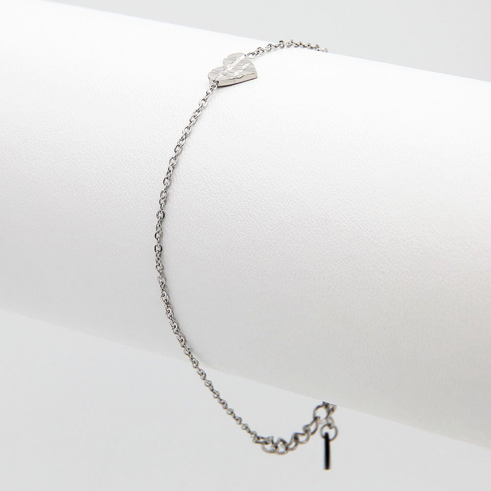 Stainless steel bracelet by Go Dutch Label. This chain bracelet features a crossed heart detail and an adjustable ring clasp. - Ozz Silver Jewelry