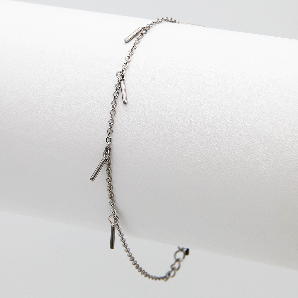 Stainless steel bracelet by Go Dutch Label. This chain bracelet features confetti charms and an adjustable ring clasp. - Ozz Silver Jewelry