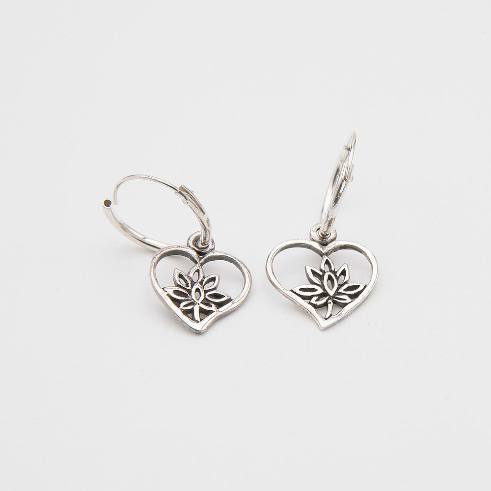 A pair of 12mm silver hoop earrings with a hanging flower heart charm. - Ozz Silver Jewelry