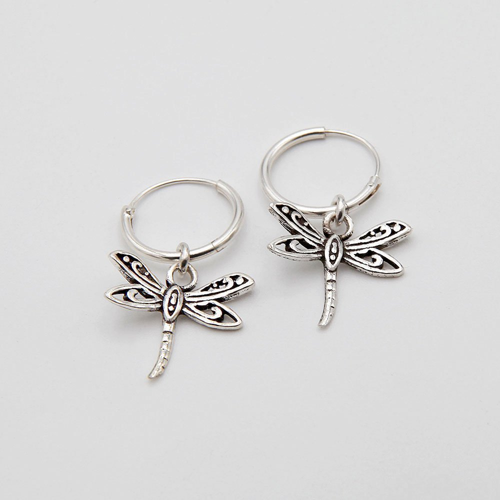 A pair of 12mm silver hoop earrings with a hanging dragonfly charm. - Ozz Silver Jewelry