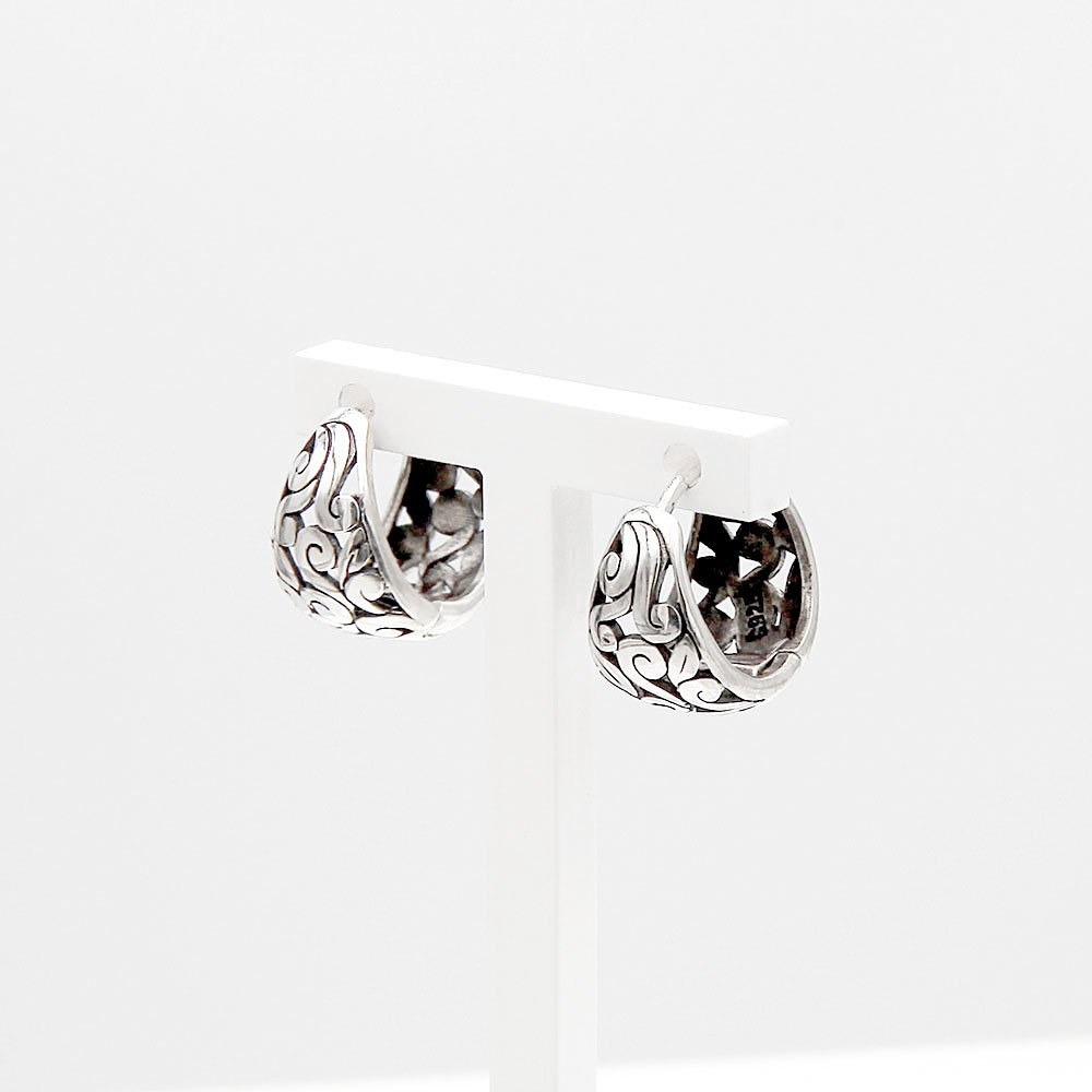 A pair of sterling silver hoop earrings with a filigree pattern. These earrings feature a concealed hinge system, which makes them easy to put on and take off. - Ozz Silver Jewelry