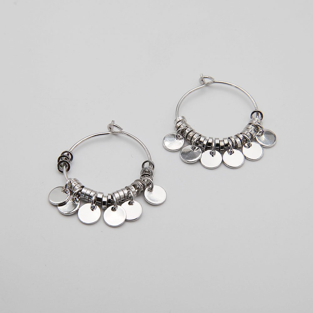 A pair of delicate stainless steel hoop earrings, featuring lovely hanging coin details. Stainless steel is a highly durable material, so this piece won't show signs of wear, won't lose its color, and is generally waterproof. - Ozz Silver Jewelry