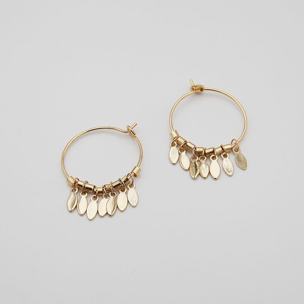 A pair of delicate stainless steel hoop earrings, featuring lovely hanging dreamcatcher details. Stainless steel is a highly durable material, so this piece won't show signs of wear, won't lose its color, and is generally waterproof. - Ozz Silver Jewelry