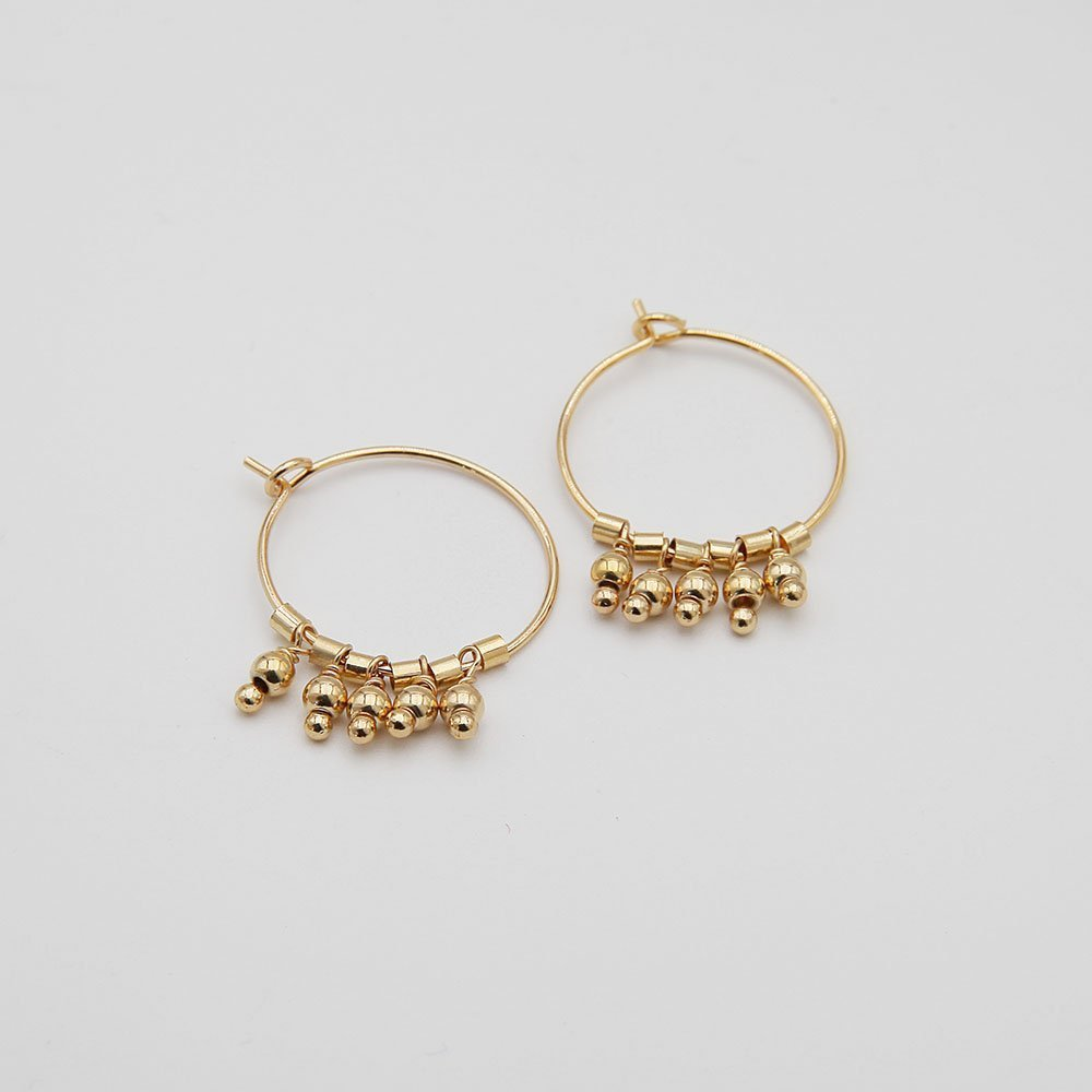 A pair of delicate stainless steel hoop earrings, featuring lovely hanging windchime details. Stainless steel is a highly durable material, so this piece won't show signs of wear, won't lose its color, and is generally waterproof. - Ozz Silver Jewelry